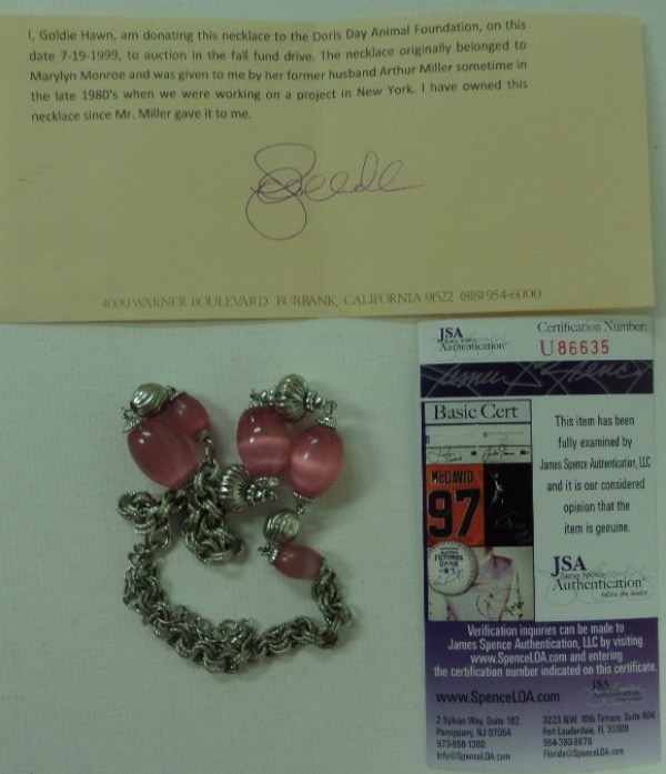 This item is a necklace, owned and worn by the late Hollywood actress, and given by her husband Arthur Miller to Goldie Hawn in the 1980's. Hawn donated it to the Doris Day Animal Foundation auction, and that hand signed letter from Hawn, on studio paper, accompanies. It even has a JSA numbered lifetime COA for provenance, and value is thousands on this must have, one of a kind Marilyn Monroe item.