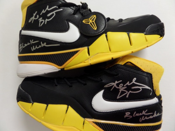 "This must have NBA showpiece is a pair of hand signed sneaks, yep, TWO autographs for one bid, and each comes signed in bold silver paint pen, and with ""Black Mamba"" written by the late HOF legend as a bonus. Both grade clean bold 10's all over, even both sneakers are stunning in black, white and gold colors, and value is many times our asking price on the just deceased superstar."