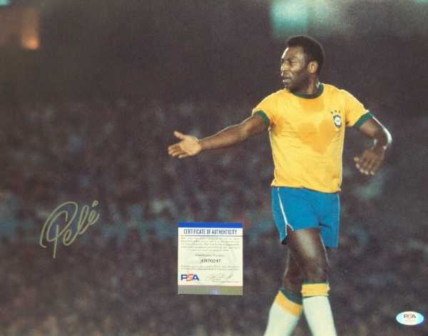 This giant 1970 world cup soccer image is a Kodak beauty, a whopping 16x20 in size, and shows the aging soccer legend in action for Team Brazil. It comes silver paint pen signed on a perfect spot.  It looks fantastic, will frame and display gorgeously, and even has lifetime authenticity added via PSA's COA and hologram (AH70247)!