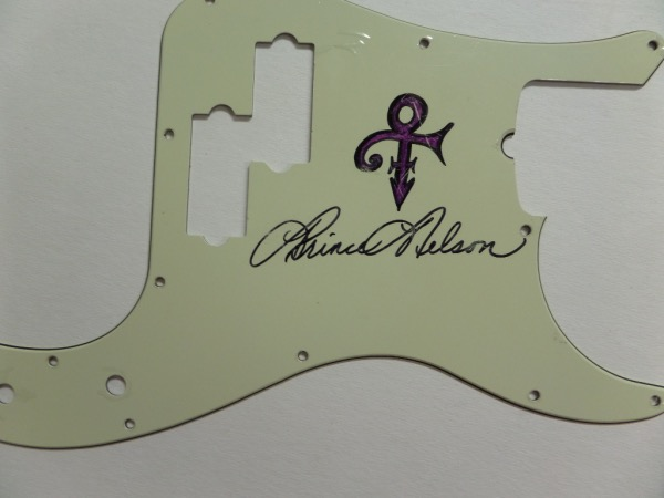 "This very rare rock n' roll item has a sky high value as he hated to sign autographs, and is the large size in cream color, It comes hand signed, full name, and in bold black sharpie, and grades a spectacular 9 all over. There is even a custom ""sign"" drawn on the guard, and value is thousands since his untimely death a few years ago."