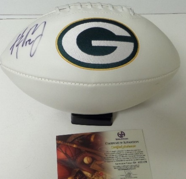 This full size, triple white panel Green Bay Packers commemorative football features an embroidered team logo and championship info.  It is hand-signed in black sharpie by the superstar and future Hall Of Fame QB, comes Global Authentics certified (GV652139) and retail here is mid hundreds, easily!