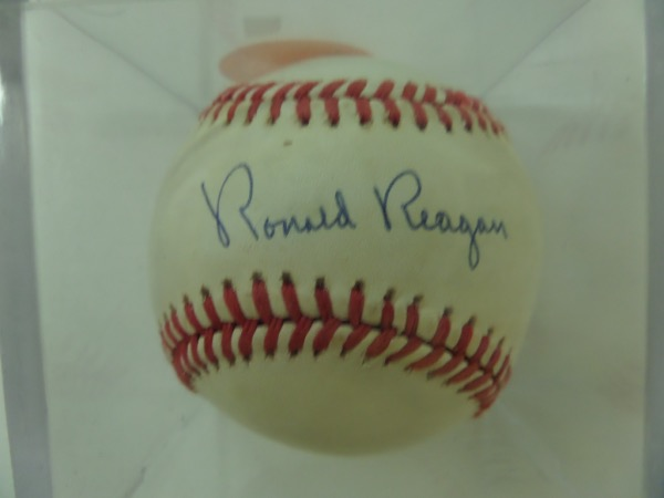 This Official National League Baseball from Rawlings is in VG+ overall condition, and comes sweet spot signed in black ink by the deceased 40th US President, Ronald Reagan.  The signature grades a legible 8.5 and the ball will show off proudly in any sporting/entertainment/political collection.  Valued into the mid/high hundreds!