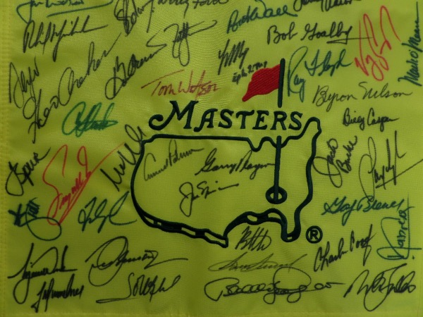 This mint, full-sized and custom embroidered pin flag is from Augusta, and comes sharpie signed by over 30 past winners. Some amazing HOF names grace this thing including Jack Nicklaus, Arnold Palmer, Tiger Woods, Gary Player, Byron Nelson, Nick Faldo, Phil Mickleson and plenty more! Grade is a super nice 10 all over, and value might be 5 grand!