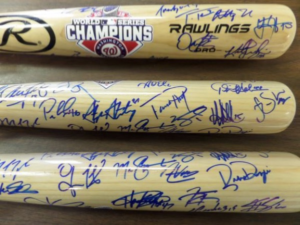 This full size Rawlings blonde bat is in NM/MT condition, and comes hand-signed in blue sharpie on the barrel by more than 20 members of the defending World Series Champion Washington Nats.  All of the big names are here, from Rendon and Soto, to Scherzer, Corbin and Strasburg, and this beautiful bat is valued well into the thousands!