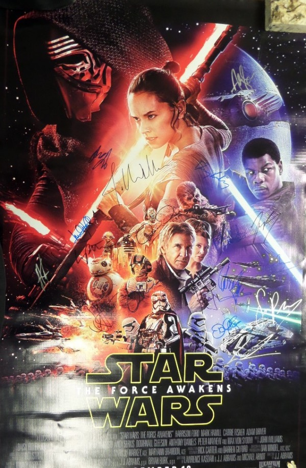 "This absolute MUST HAVE ""Star Wars"" collectors item is a full size movie poster for the 2015 hit 7th ""Star Wars"" installment, ""The Force Awakens,"" done on a nice thicker, almost canvas style stock.  It is enormous, colorful, and comes hand-signed by saga creator George Lucas and 15 of the stars of this amazing reboot, including, but not limited to, Daisy Ridley, Harrison Ford, Carrie Fisher, John Boyega, Adam Driver, Andy Serkis, Peter Mayhew, Anthony Daniels, Kenny Baker, and more.  This baby can easily retail into the low thousands, but we'll start the bidding at but a tiny percentage of that!"