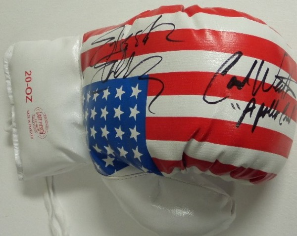 "This mint lace-up  ounce 20 ounce glove has the US flag on it and comes signed GORGEOUSLY by both of these ROCKY superstars in black sharpie with Carl including ""Apollo Creed"" with his autograph! Ideal display glove and guaranteed authentic. Retails in the high hundreds+. Rare."