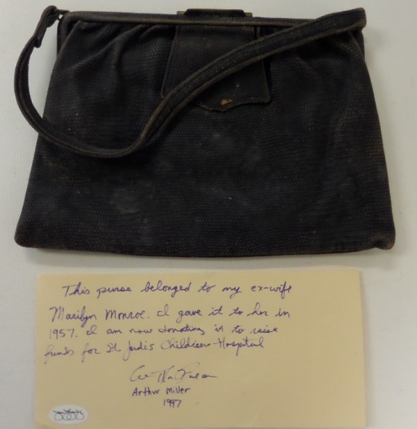 "This super rare Hollywood item is a vintage purse that belonged to the star, and was given to her by husband Arthur Miller. A hand written/signed not from his accompanies, it has a Jimmy Spence ""JSA"" hologram evident, and Miller donated it in 1997 to St. Jude's to raise money for the childrens hospital. Cool piece, one of a kind, and is value truly thousands?"