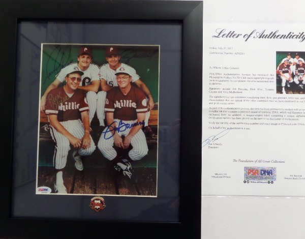 This fully certified PSA/DNA piece is matted and framed professionally, and holds a group color 8x10 which shows, and comes hand signed by, every living Phillies hurler to throw a no-hitter. I see signatures from Rick Wise, Tommy Greene, Terry Mulholland and late HOF'er Jim Bunning. It grades as good as it gets, and value, especially to a true Phillies fan, is priceless!