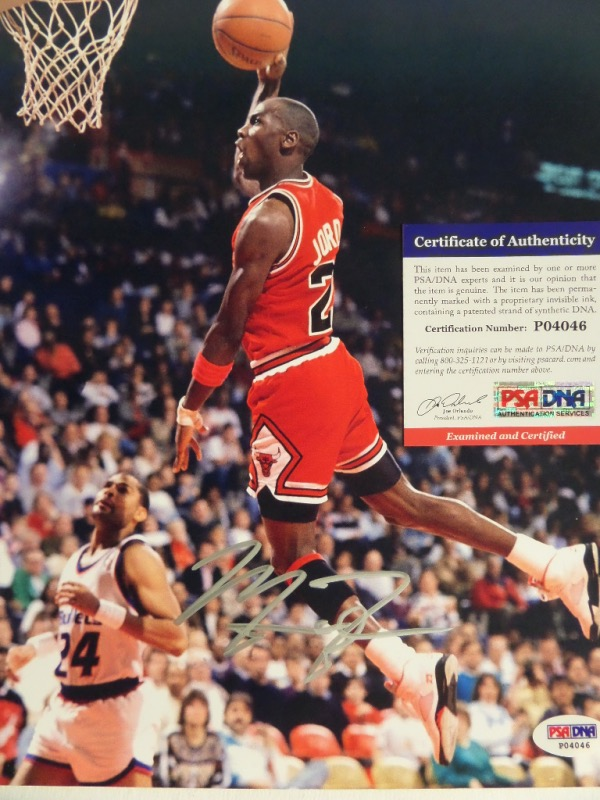 This color action 8x10 shows Michael Jordan slamming one home as a member of the Chicago Bulls.  It is hand-signed in silver by His Airness himself, grading about an 8 overall, and comes certified by PSA/DNA (P04046) for authenticity purposes.  Retail is easily high hundreds on this frame-ready gem!
