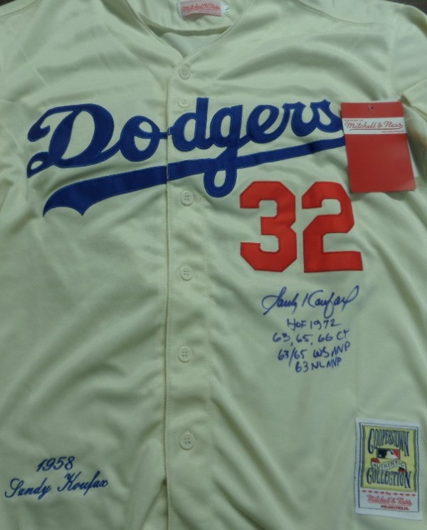 This mint LA home white is trimmed in blue and red, and comes dated from the 1958 season by Mitchell & Ness. It is a real gem, comes blue sharpie, front side signed by the HOF pitcher, and with career stats written too. It grades a superb 10 all over, has Lee's full ok added for certainty, and value is $1200.00 or so.