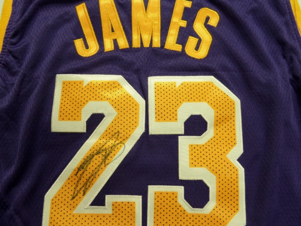 This mint purple beauty is trimmed in Laker gold and comes signed on the back by the best (or second best) player to ever get on the court.  Great signature and shows off wonderfully on this authentic-style jersey!  As I am typing this He is poised for another ring this year! Book value in the thousands.
