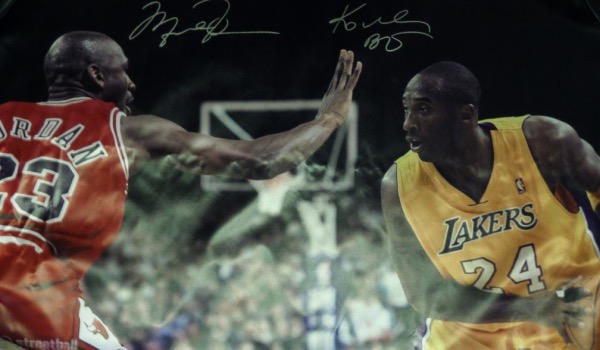This HUGE full color nylon print shows both Mike and Kobe during a Lakers-Bulls game from the 90's, and comes silver paint pen signed by both HOF Greats. The signatures are both large bold 10's, can be seen from 40+ feet away easily, and value if perfect might be 3 grand with Kobe just deceased and Mike hard as ever to get. It has some crinkles from shipping. They might come matted our easily, but we have no idea. Please bid accordingly!
