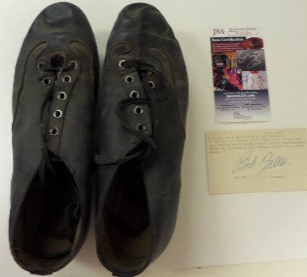 This vintage, well worn old pair of black leather spikes were worn by the late HOF pitcher during the 1948 world series in Cleveland, and so says HOF teamate Bob Feller, and authenticator Jimmy Spence. Great chance, 2 pieces of certainty are here, and value on the HOF worthy display pieces is possibly thousands.