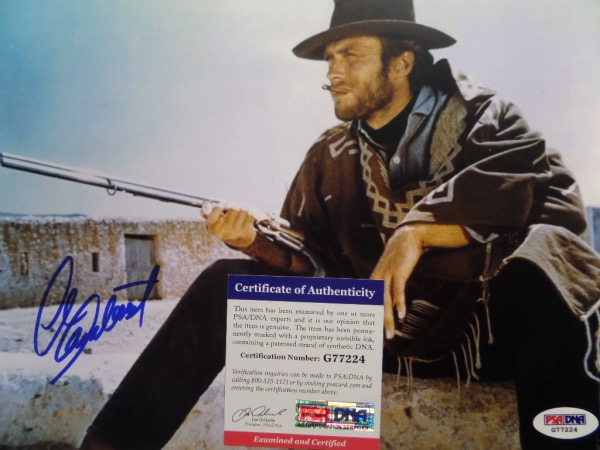 "This full color 8.5x10.5 shows Clint Eastwood dressed as his famed ""Man With No Name"" character in one of Sergio Leone's well-known ""Spaghetti Westerns.""  It is hand-signed in blue sharpie by the legendary actor, and comes fully certified by PSA/DNA (G77224) for authenticity purposes.  Valued well into the hundreds!"