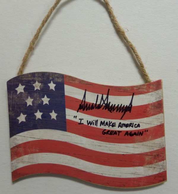 "This unique political collector's item is a wooden American Flag, in overall EX condition, and measuring about 4x6 in size, with a rope at the top for hanging.  It is hand-signed by #45 himself, United States President, Donald Trump, and grades an overall 9, complete with an ""I Will Make America Great Again"" inscription.  A super cool item, valued at PRICELESS!"