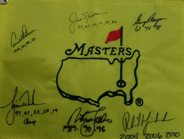 This mint, gold, full-sized pin flag is a gem and comes black sharpie signed by 6 legends, all of whom have won the tourney at least THREE times!!! It grades a clean bold 10 all over the place, shows off well from across our auction room, and has autographs from Tiger Woods, jack Nicklaus, Arnold Palmer, Phil Mickleson, Nick Faldo and Gary Player. Solid sports investment, value is thousands, yet our minimum is just that.