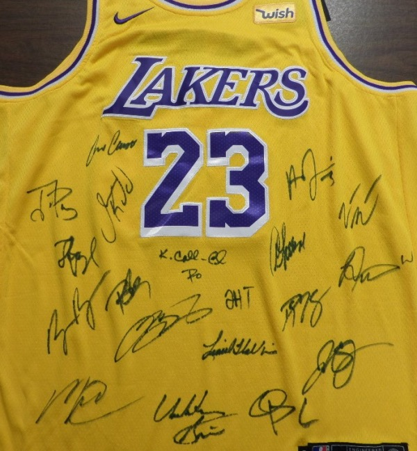 "This mint home LA gold is trimmed in white and purple team colors, has ""James"" as in Lebron sewn on back, and comes front side signed by everyone. I see 19 signatures in all, every player and the coaches, and grade is an IN PERSON obtained 10 everywhere! Amazing NBA chance, ""King James'"" 4th NBA title, and value is thousands."
