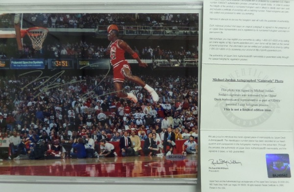 "This full color 8x10 photo shows Michael Jordan in mid air during his iconic dunk contest winning slam.  It is hand-signed in silver by the Bulls legend and ""Last Dance"" star himself, and comes fully certified by Upper Deck (BAJ40562) for rock solid authenticity.  Valued into the low thousands!"