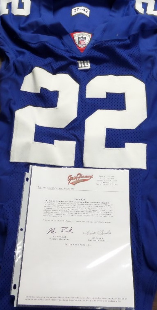 This blue #22 Droughns New York Giants jersey has all the proper tagging, and was worn in actual NFL action by running back, Reuben Droughns.  The jersey looks simply fantastic, will show off brilliantly in any Giants collection, and a full LOA from Grey Flannel accompanies for rock solid authenticity.  Valued well into the hundreds!