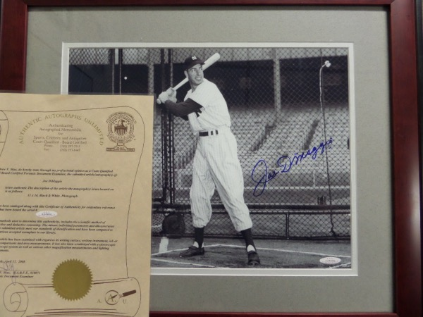 This 1946 B&W stunner is a glossy 11x14 photo, shows Joe D. ready to hit, and during a night time photo session. It is a beauty, comes boldly blue sharpie signed, and is then custom double matted and professionally framed in cherry wood. It is about 20x24 total in size, has the AAU lifetime hologram and added LOA, and value in the super-size is about a grand.
