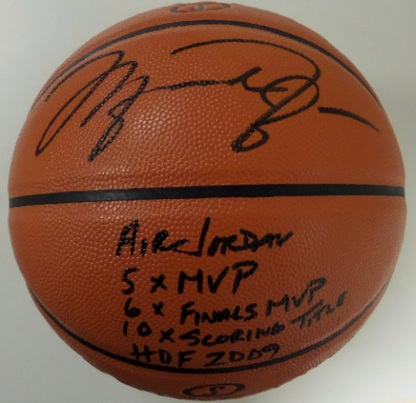 This Game Ball Series basketball from Spalding is boxed in MINT condition, and comes hand-signed in bold black sharpie by NBA All Time Great, Michael Jordan.  The signature grades a sharp, legible 8.5, including 2009 HOF, Air Jordan, 5X MVP, 6X Finals MVP, and 10X Scoring Title inscriptions, and the ball is valued into the very high hundreds!