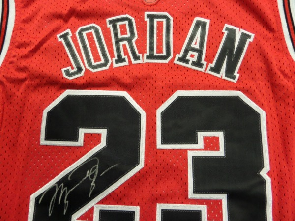 This red size 50 jersey is in the style of the classic Bulls jersey, trimmed in white and black, with everything sewn, and original Nike tagging attached.  It is back number-signed in silver sharpie by the 5 time league MVP and HOF'er, grading a legible 8 overall, and will show off fabulously upon display.  Valued well into the hundreds!