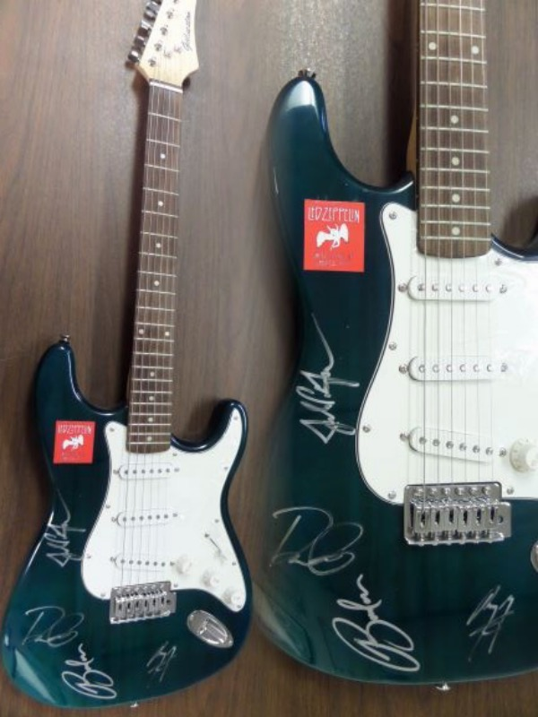 This must have rock n' roll HOF item is a mint, full-sized electric guitar, and comes proudly signed by all 4 legendary members. Of course Robert Plant, Jimmy Page, John Paul Jones and Jason Bonham are here, grade is a 9 in silver paint pen, and value is thousands on this easy musical buy and hold investment item.