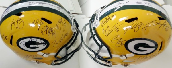 This mint Riddell Speed helmet comes signed by approx. 20+ stars from this team which as of right now is in the Championship game for the NFC.  Included are ALL of the big names like Coach LeFleur, RODGERS, JONES, ADAMS, BAHKTIARI, CROSBY, LINSLEY, ALEXANDER,SMITH,ETC..  A must for the cheesehead collector and can they win it all and retail skyrockets?