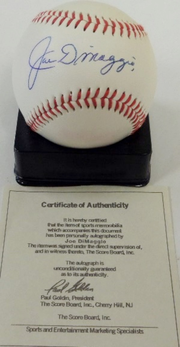 This Official American League Baseball from Rawlings is in EX+ condition, and comes dark blue ink signed across the sweet spot by the 3 time AL MVP and deceased Yankees HOF centerfielder, Joe DiMaggio.  The signature grades a nice, legible 8.5-9 overall, and a COA is included from The Score Board, Inc for authenticity purposes.  Valued at $600.00!!!!
