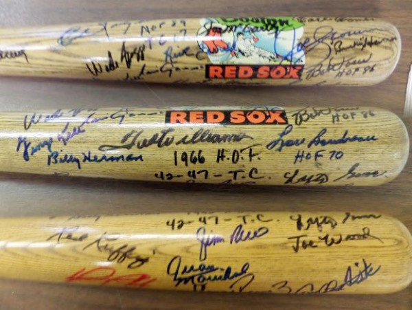This special, one of a kind collectible is a special issue team bat, one we have never seen before, and comes black and blue sharpie signed by many. I see autographs from Yaz, Seaver, Boggs, Fik, Ortiz, Rice, Lefty Grove, Ted Williams and many many more,. Most are deceased, value is thousands, and the names are amazing!