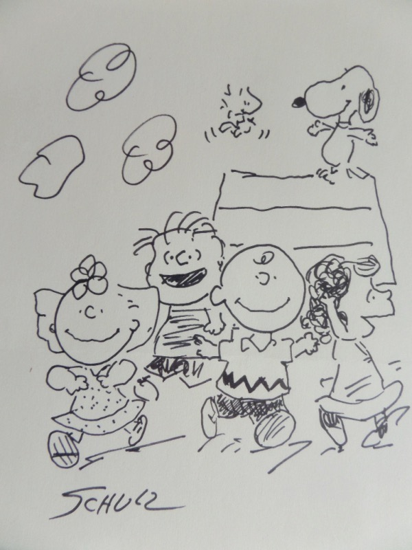 "This wonderful 1977 era work is all by hand, measures near 8x10 in size, and shows everyone from the ""Peanuts"" gang. It comes right from, and is hand signed by late creator Charles Schulz, and value is sky high on the rare ""Whole Gang"" work. Of course it is hand signed, in perfect shape, and value is $2500.00 all the live long day."