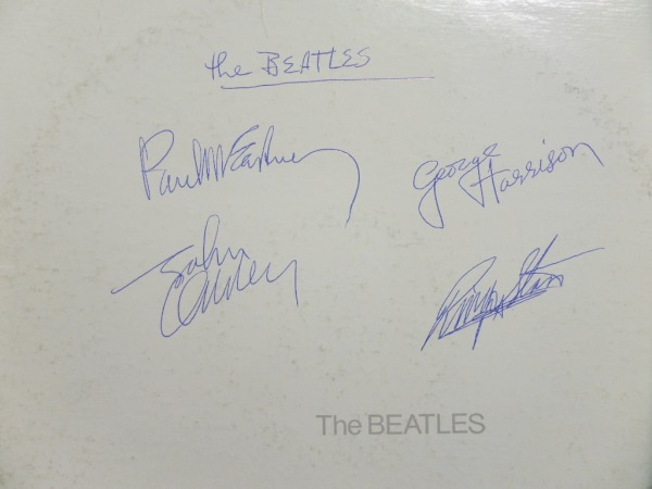 "This vintage LP is their ""White"" album, in about fine condition overall, and blue ink signed by all 4 mop topped superstars. The 4 signatures are all bold clean 9's, show off easily from 20+ feet away, and value is $4 grand in some areas."